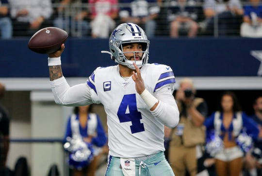 Dallas Cowboys quarterback Dak Prescott (4) throws a pass in the first half of an NFL football game against the Green Bay Packers in Arlington, Texas, Sunday, Oct. 6, 2019.