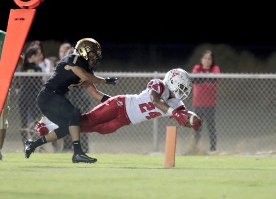 Palm Springs' Jason Roberts scores a touchdown during the game against Xavier in Palm Desert, Calif., on Saturday, October 5, 2019.