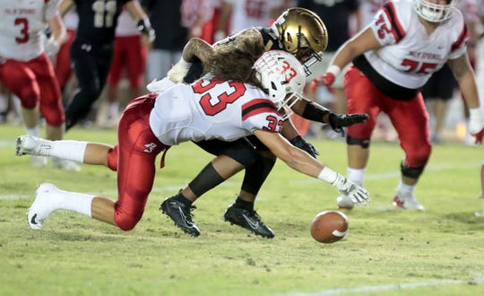Palm Springs' Casey Libretti (33) battles for the ball against Xavier in Palm Desert, Calif., on Saturday, October 5, 2019.