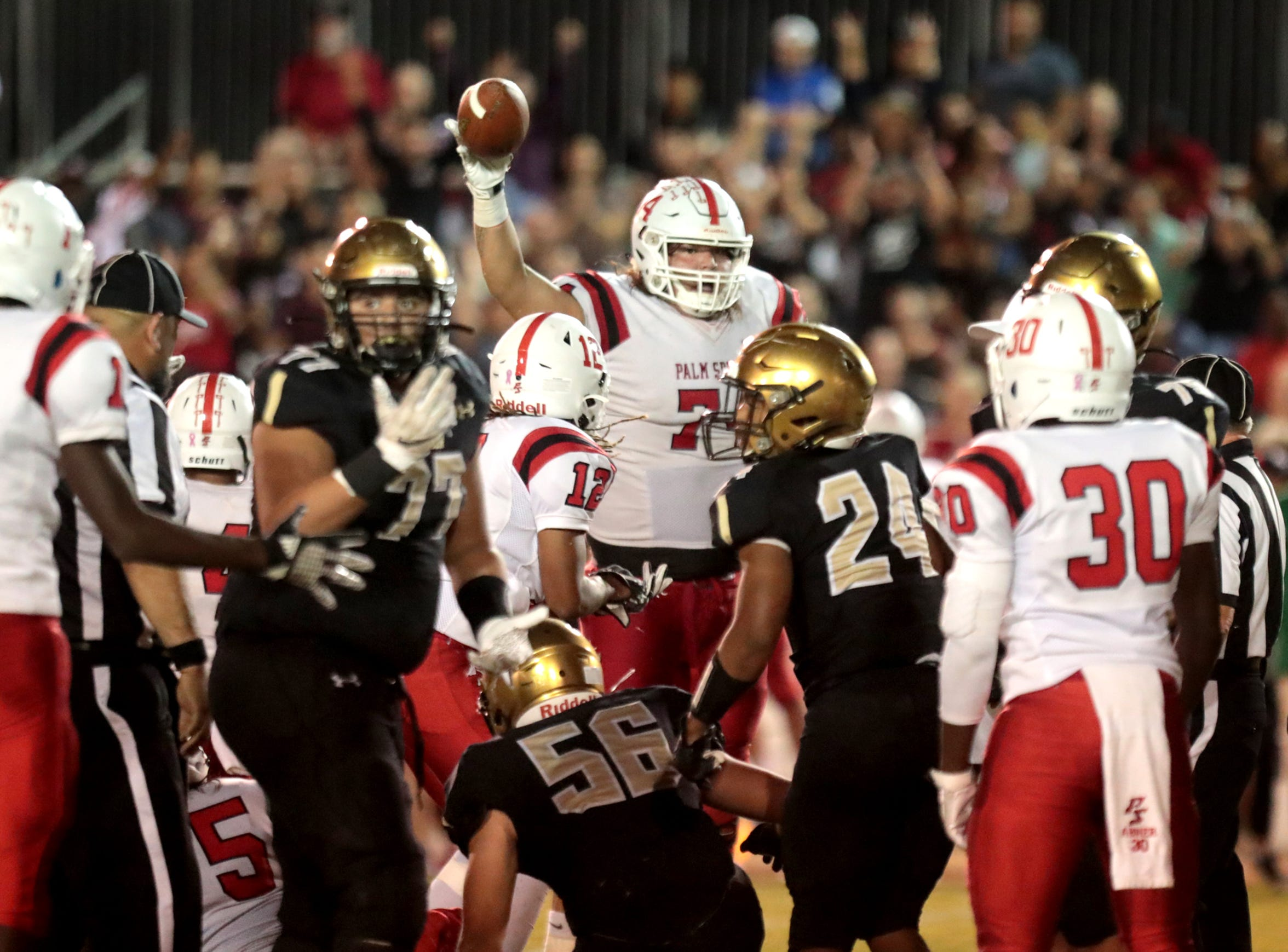 Palm Springs' Julian Polendo (74) will decide this month where he will play college football.