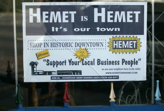 Following the recession, Hemet was plagued by crime, vacancy and business closures. In this 2010 file photo, a Downtown Hemet Business Association sign appears behind a Florida Avenue business's cracked window.
