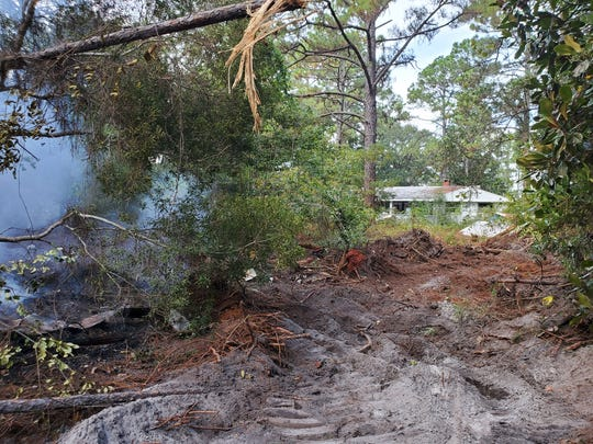 Firefighters responded to a wildfire early Sunday morning in the 6500 block of East Bay Boulevard in the Midway area of south Santa Rosa County.
