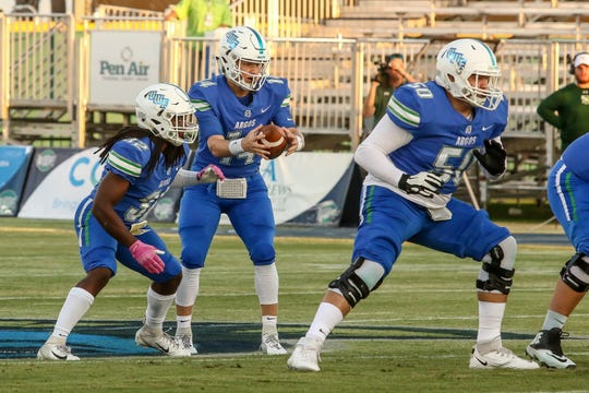 UWF quarterback Austin Reed (14) takes a snap against Delta State on Saturday, October 5, 2019, during the homecoming game at Blue Wahoos Stadium.