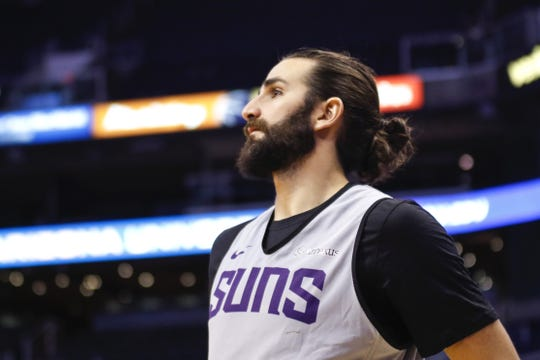 Phoenix Suns Guard Ricky Rubio looks on after shooting a shot during the Suns Open Practice on Oct. 6, 2019 in Phoenix, Ariz.