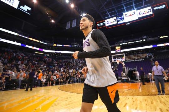 Phoenix Suns Guard Devin Booker walks off the court following the Suns Open Practice on Oct. 6, 2019 in Phoenix, Ariz.