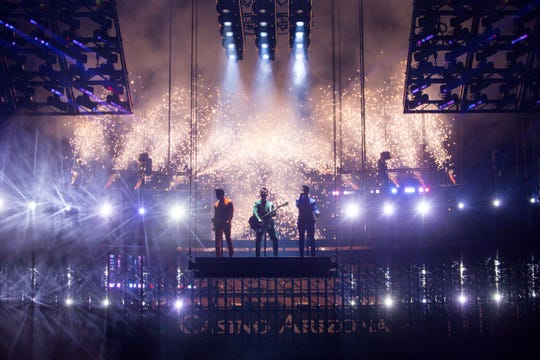 The Jonas Brothers descend from the rafters to take the stage at Talking Stick Arena on Oct. 5, 2019 in Phoenix.