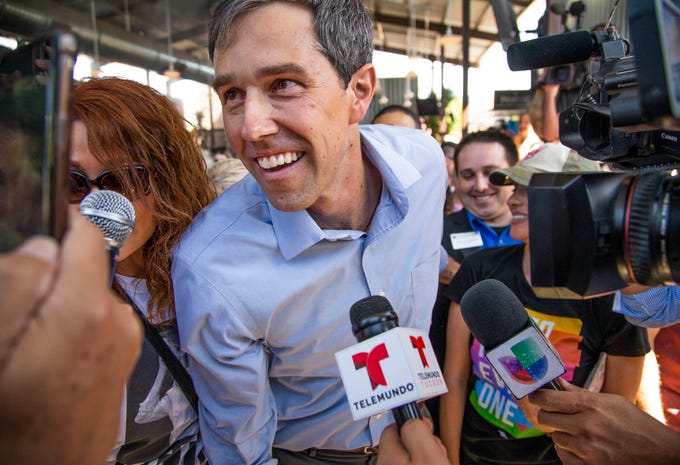 Democratic presidential candidate Beto O'Rourke makes his way through the crowd after delivering a stump speech at The Churchill, a downtown Phoenix bar, Sunday, October 6, 2019.