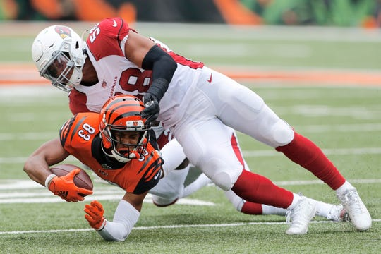 Cardinals linebacker Jordan Hicks makes a tackle on Bengals receiver Tyler Boyd during a game Oct. 6 at Paul Brown Stadium.