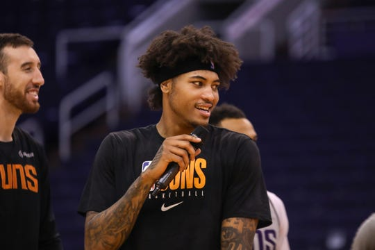 Phoenix Suns Forward Kelly Oubre Jr. talks to the crowd during the Suns Open Practice on Oct. 6, 2019 in Phoenix, Ariz.