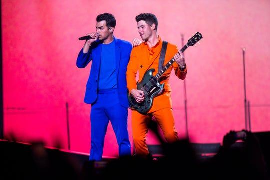 Joe Jonas and Nick Jonas perform with the Jonas Brothers at Talking Stick Arena on Oct. 5, 2019 in Phoenix.