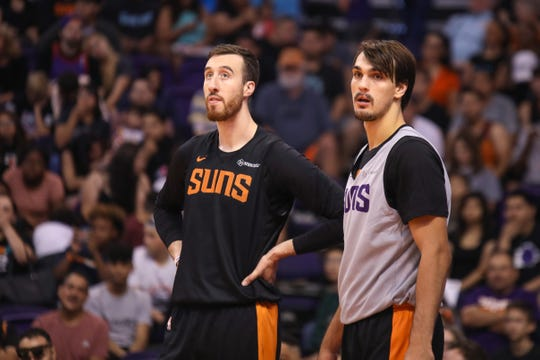Phoenix Suns Forwards Frank Kaminsky III (left) and Dario Šarić (right) watch practice during the Suns Open Practice  on Oct. 6, 2019 in Phoenix, Ariz.