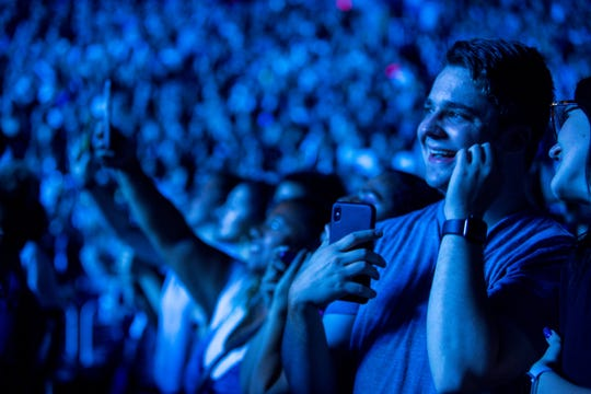 Fans cheer as the Jonas Brothers come onstage at Talking Stick Arena on Oct. 5, 2019 in Phoenix.