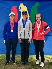 Port Huron Northern sophomore (right) Madison Bajis became the first alternate at the Drive, Chip and Putt regional Saturday, Oct. 5, 2019, at Oakland Hills. Kate Brody of Grand Blanc (middle) and Mia Raines of Ohio (left) took first and second place, respectively.