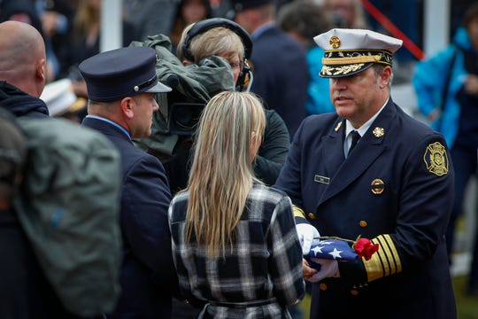 Casey Flanscha, center, accepts a flag flown over Congress, during the National Fallen Firefighters Memorial,  Sunday, October 6, 2019, in Emmitsburg, MD.  119 Firefighters killed in the line of duty in 2018, including York's Zachary Anthony and Ivan Flanscha, were honored during an annual memorial. 