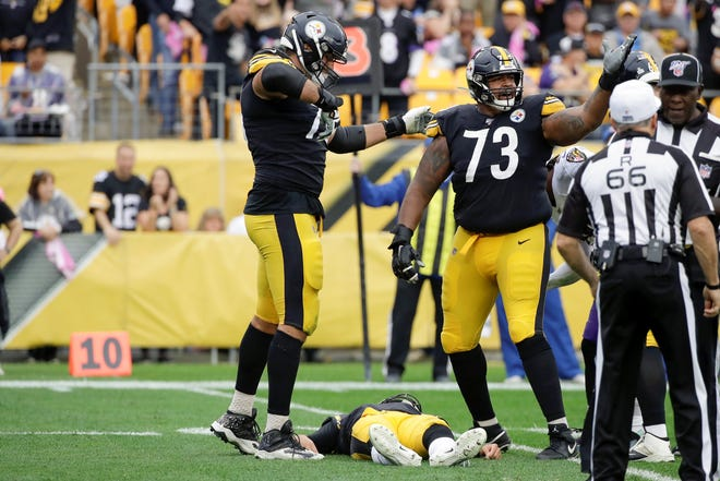 Pittsburgh Steelers offensive guards Ramon Foster (73) and Alejandro Villanueva (78) call for help after quarterback Mason Rudolph was injured against the Baltimore Ravens on Sunday. (AP Photo/Don Wright)