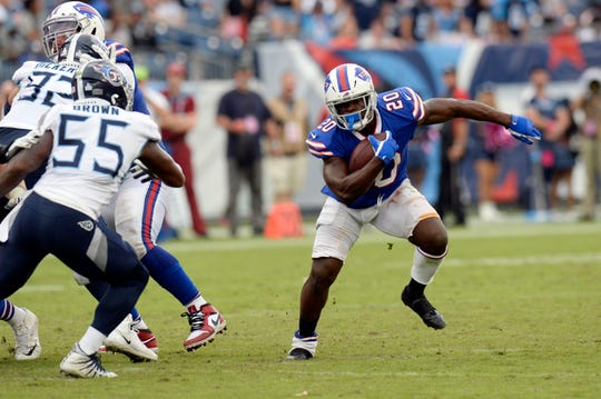 Buffalo Bills running back Frank Gore tries to get past Tennessee Titans inside linebacker Jayon Brown (55) in the second half of an NFL football game Sunday, Oct. 6, 2019, in Nashville, Tenn. Gore finished the day with 14 carries for 60 yards and shined brightest in the fourth quarter.
