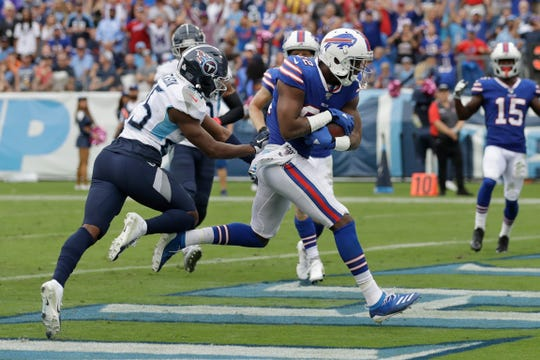 Buffalo Bills wide receiver Duke Williams (82) scores a touchdown on a 7-yard pass play against the Tennessee Titans.