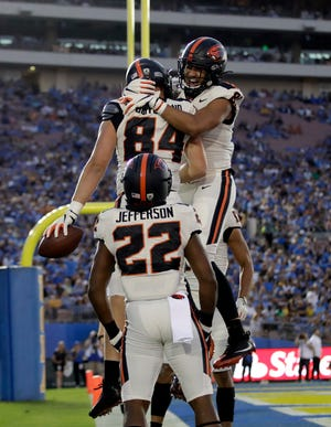 Oregon State tight end Teagan Quitoriano (84) celebrates with teammates after a touchdown catch against UCLA during the first half of an NCAA college football game Saturday, Oct. 5, 2019, in Pasadena, Calif. (AP Photo/Marcio Jose Sanchez)