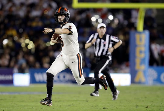 Oregon State quarterback Jake Luton runs against UCLA during the second half of an NCAA college football game Saturday, Oct. 5, 2019, in Pasadena, Calif. (AP Photo/Marcio Jose Sanchez)