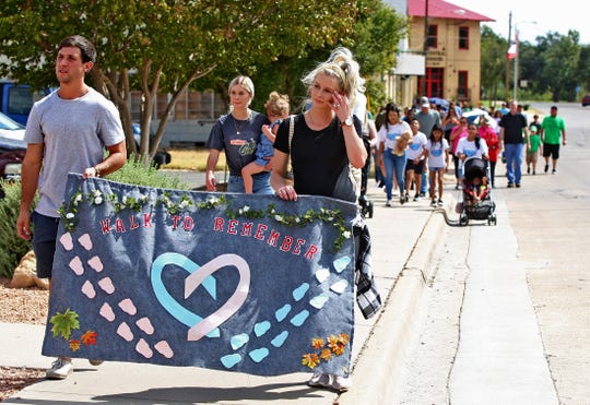 Dozens of people head toward Shannon Medical Center during the Walk to Remember event Sunday, Oct. 6, 2019.