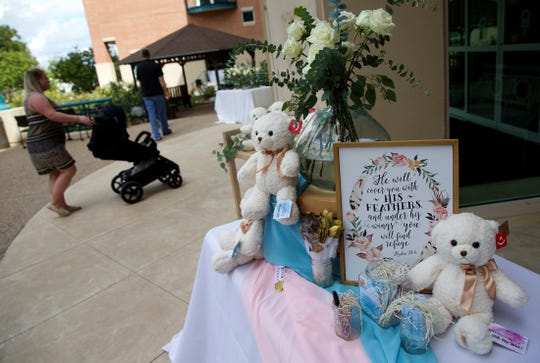 White Rose Teddy Bears for families that have lost a baby sit on a table at the Walk to Remember event at Shannon Medical Center on Sunday, Oct. 6, 2019.