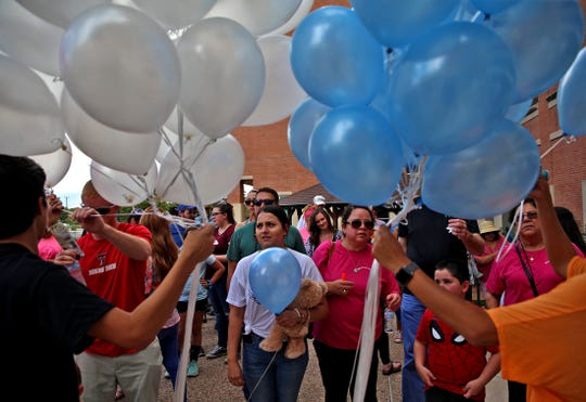 People at the Walk to Remember event at Shannon Medical Center prepare to release balloons Sunday, Oct. 6, 2019.