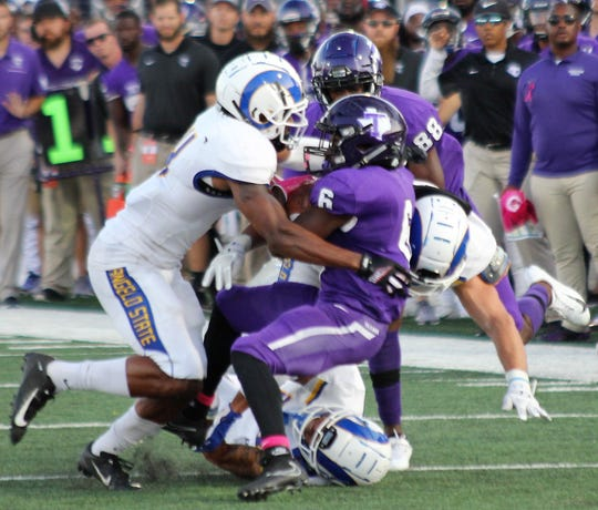 An Angelo State University defender tackles Tarleton State running back Daniel McCants during a Lone Star Conference game at Memorial Stadium in Stephenville on Saturday, Oct. 5, 2019.
