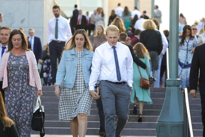 People arrive for The Church of Jesus Christ of Latter-day Saints' twice-annual church conference Saturday, Oct. 5, 2019, in Salt Lake City. Nelson has rolled out a dizzying number of policy changes during his first two years at the helm of the faith, leading to heightened anticipation for what he may announce at this weekend's conference in Salt Lake City. (AP Photo/Rick Bowmer)