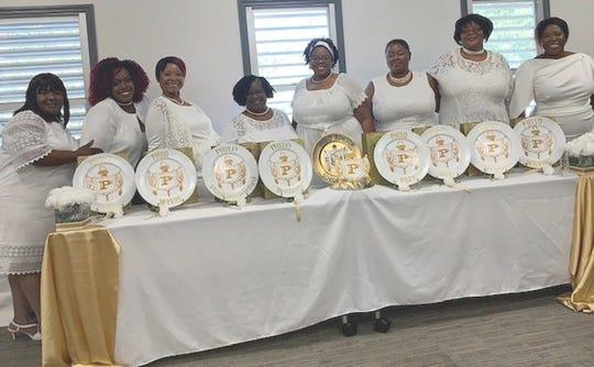 Eight of the nine new Beta Delta Sigma Philo Affiliate members.
