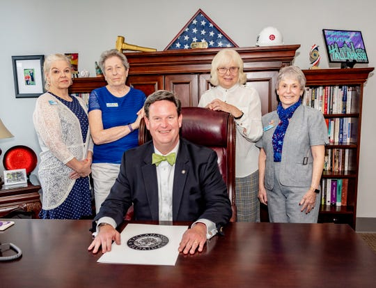 Seated: Mayor John Dailey; Standing: Betty Davis, Mary Courtemanche, Judy Leclere and Deborah Stubing.