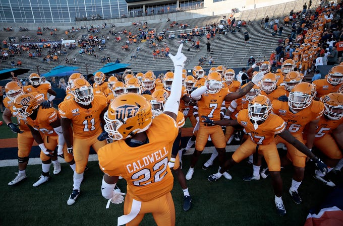 UTEP's Josh Caldwell leads the Miners onto the field Saturday to face UTSA at the Sun Bowl.