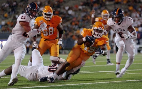 UTEP running back Treyvon Hughes battles into the endzone against UTSA Saturday at the Sun Bowl.
