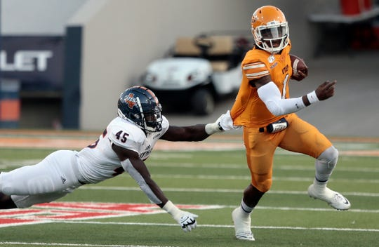 UTEP quarterback Kai Locksley outruns UTSA's DeQuarius Henry Saturday at the Sun Bowl.