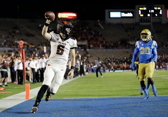 Oregon State quarterback Jake Luton, who starred at Ventura College, runs for a touchdown during the Beavers' win at UCLA on Saturday night.
