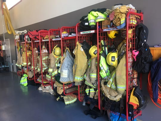 Firefighting gear hangs inside Oxnard Fire Department Station 1. The department hosted an open house to mark the start of National Fire Prevention Week.