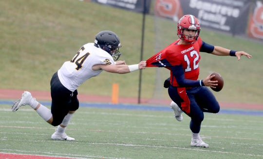 Quarterback Joey Carino of Archbishop Stepinac is grabbed by Kieran McKenna of St. Anthony's during a Catholic High School Football League game at Archbishop Stepinac High School in White Plains Oct. 6, 2019. Stepinac defeated St. Anthony's 42-7.