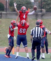 Matt Halas of Archbishop Stepinac celebrates with teammates after scoring a touchdown on Stepinac's first play from scrimmage in the first quarter touchdown of a Catholic High School Football League game against St. Anthony's at Archbishop Stepinac High School in White Plains Oct. 6, 2019. Stepinac defeated St. Anthony's 42-7.