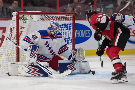 Oct 5, 2019; Ottawa, Ontario, CAN; New York Rangers goalie Alexandar Georgiev (40) makes a save on a shot from Ottawa Senators right wing Connor Brown (22) in the second period at the Canadian Tire Centre. Mandatory Credit: Marc DesRosiers-USA TODAY Sports
