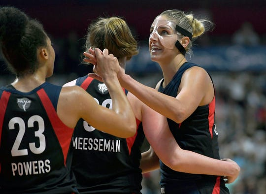 Washington Mystics' Elena Delle Donne, right, celebrates with Aerial Powers, left, and Meesseman as time winds down during the second half in Game 3 of basketball's WNBA Finals against the Connecticut Sun, Sunday, Oct. 6, 2019, in Uncasville, Conn.