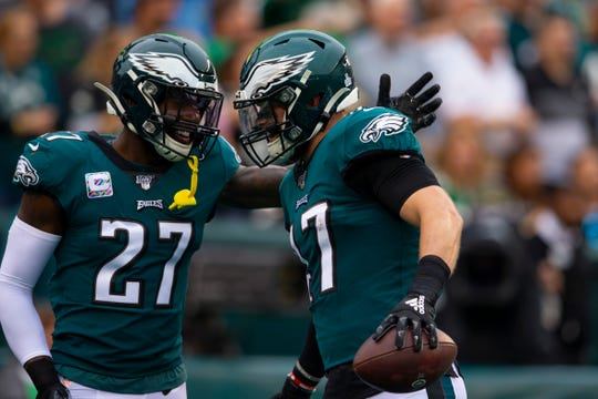 Malcolm Jenkins #27 of the Philadelphia Eagles congratulates Nate Gerry #47 after his interception and return for a touchdown in the first quarter against the New York Jets at Lincoln Financial Field on October 6, 2019 in Philadelphia.