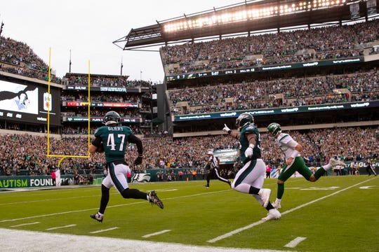 Nate Gerry of the Philadelphia Eagles intercepts a pass and returns it for a touchdown in the first quarter against the New York Jets at Lincoln Financial Field Sunday.