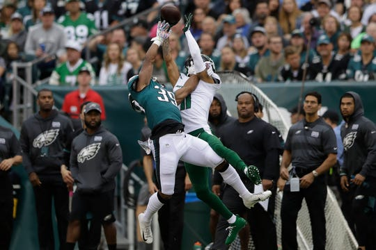 New York Jets' Robby Anderson, right, cannot catch a pass against Philadelphia Eagles' Craig James during the first half of an NFL football game, Sunday, Oct. 6, 2019, in Philadelphia.