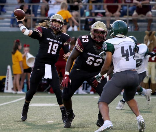 Midwestern State's Triston Williams passes in the game against Eastern New Mexico Saturday, Oct. 5, 2019, in Memorial Stadium