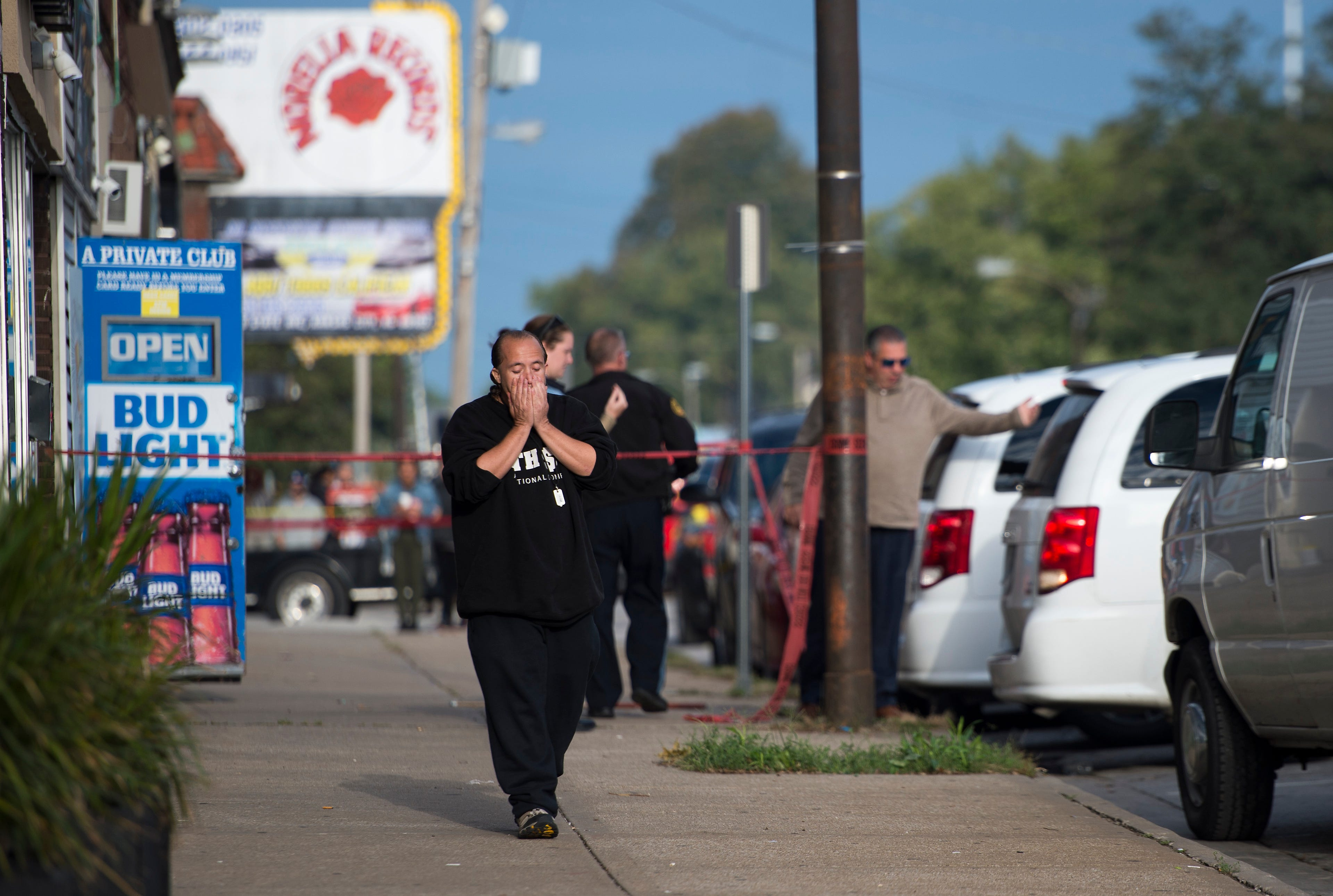 Breaking news: One suspect nabbed, one sought in shooting rampage that killed 4, wounded 5 in Kansas bar