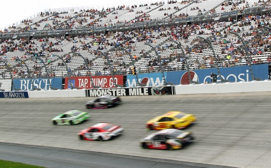 NASCAR Cup Series cars race during the 2018 playoff race at Dover International Speedway.