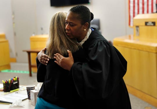 State District Judge Tammy Kemp returns Amber Guyger's hug on Oct. 2, 2019, in Dallas.