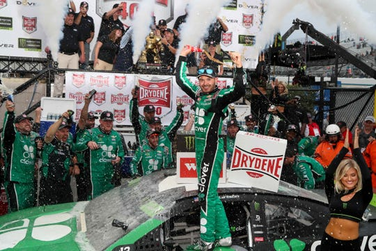 Kyle Larson celebrates in victory lane after winning the Drydene 400 at Dover International Speedway.