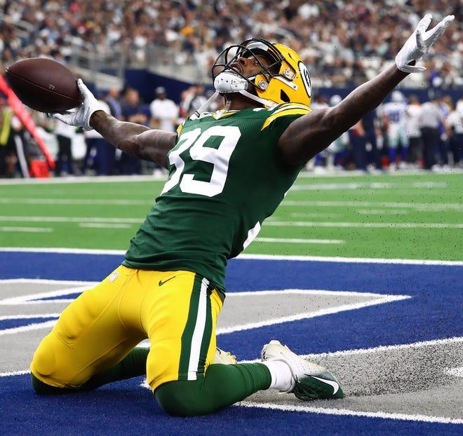 Green Bay Packers cornerback Chandon Sullivan celebrates a second quarter interception against the Dallas Cowboys at AT&T Stadium.