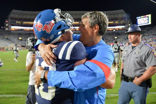 Mississippi Rebels head coach Matt Luke celebrates with quarterback John Rhys Plumlee (10) after the game against the Vanderbilt Commodores at Vaught-Hemingway Stadium. TODAY Sports