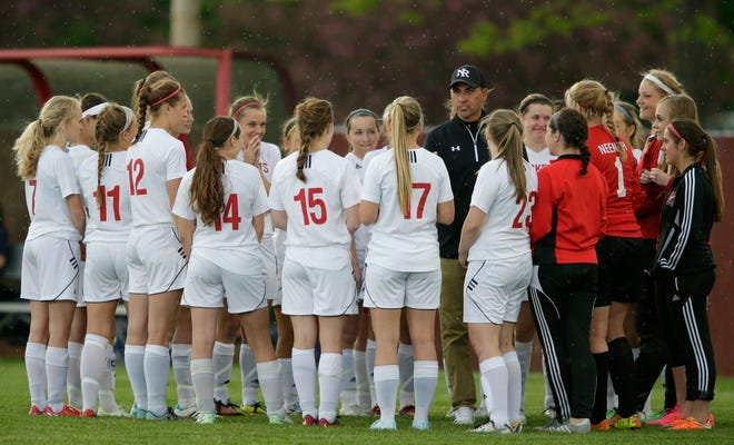Neenah girls soccer coach Jeff Zehren talks to his team prior to a game on May 19, 2015. Zehren resigned as the Rockets coach Friday after nine seasons.